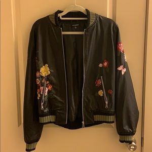 Black faux leather jacket with stitched details